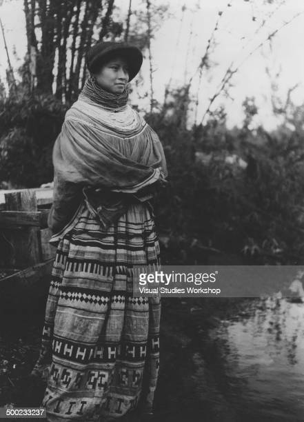 A Seminole Indian woman from the Muskhogean tribe originally made up of immigrants from the Lower Creek towns on the Chattahoochee River Florida...
