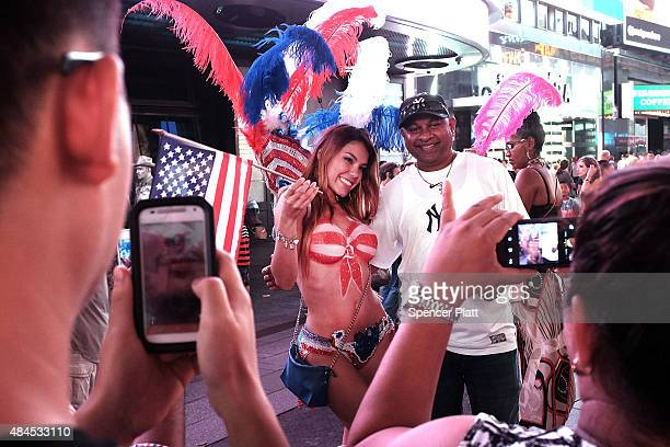 A seminude model poses for a photo in Times Square on August 19 2015 in New York City As the iconic Times Square continues to draw tourists with its...
