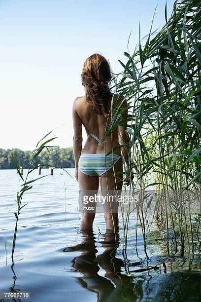 Semi-nude Young Woman at Lake