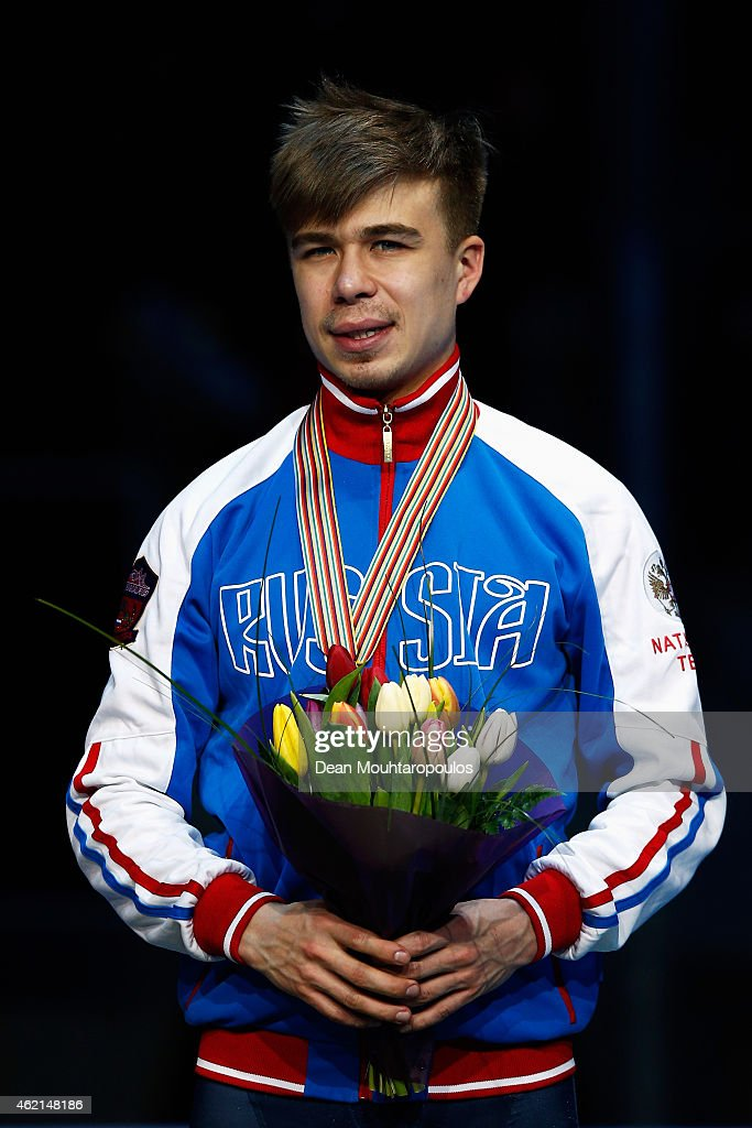 Semion Elistratov of Russia poses on the podium after his bronze medal in Final standings during day 3 of the ISU European Short Track Speed Skating Championships at The Sportboulevard on January 25, 2015 in Dordrecht, Netherlands.