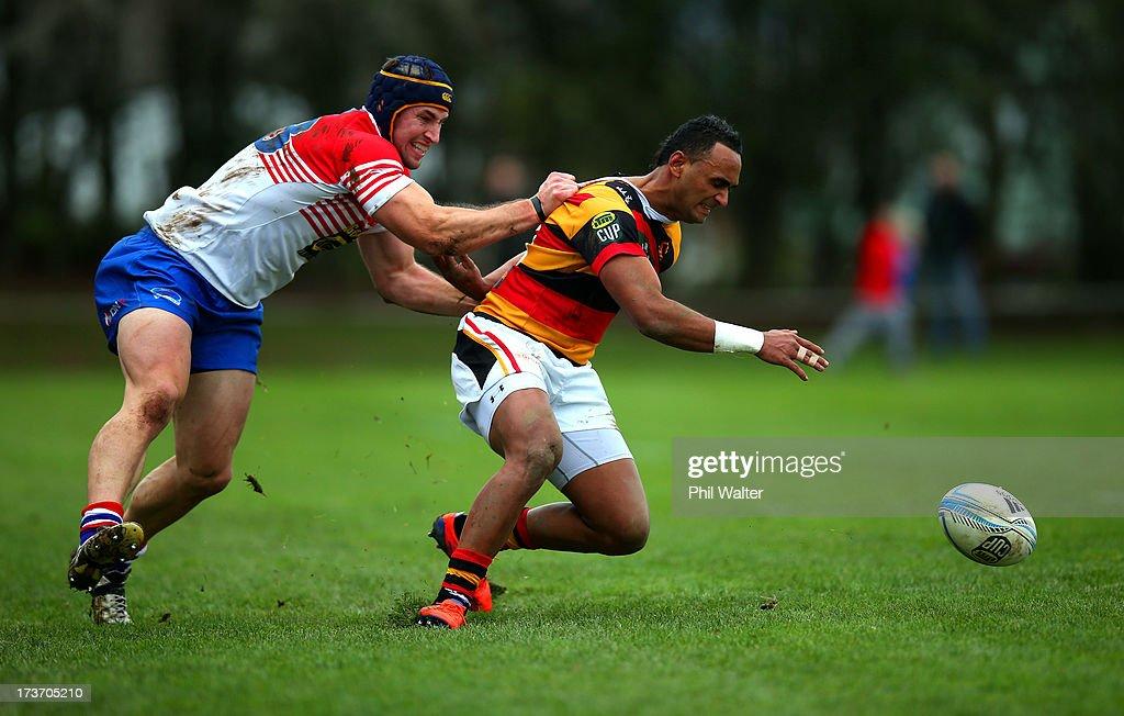 Semisi Masirewa of Waikato is tackled by David Thompson of Horowhenua-Kapiti during the Ranfurly Shield match between Waikato and Horowhenua-Kapiti at the Morrinsville Domain on July 17, 2013 in Morrinsville, New Zealand.