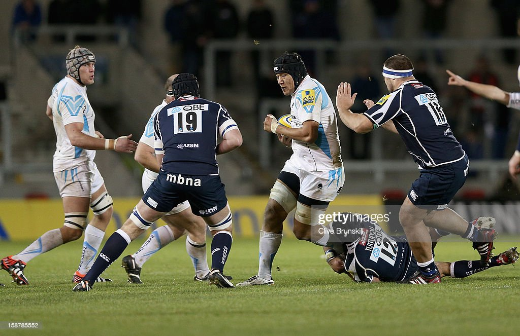 Semisi Taulava of Worcester Warriors attempts to move past Fraser McKenzie of Sale Sharks during the Aviva Premiership match between Sale Sharks and Worcester Warriors at Salford City Stadium on December 28, 2012 in Salford, England.