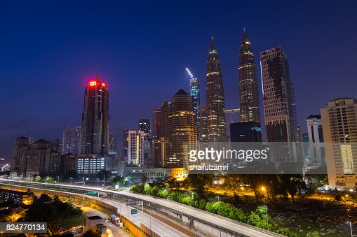 Semi-silhouette of Kuala Lumpur city during sunrise. Its modern skyline is dominated by the 451m-tall KLCC. : Stock Photo