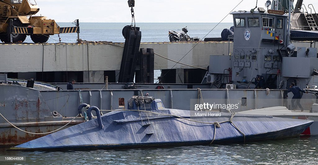 A semi-submersible, used for drug running, sits in a naval impound lot on Colombia's Pacific coast. When in operation, only the vessel's top cabin would have emerged from the water, making it difficult to detect. Colombia's Pacific is a hotbed for such narco-innovation.