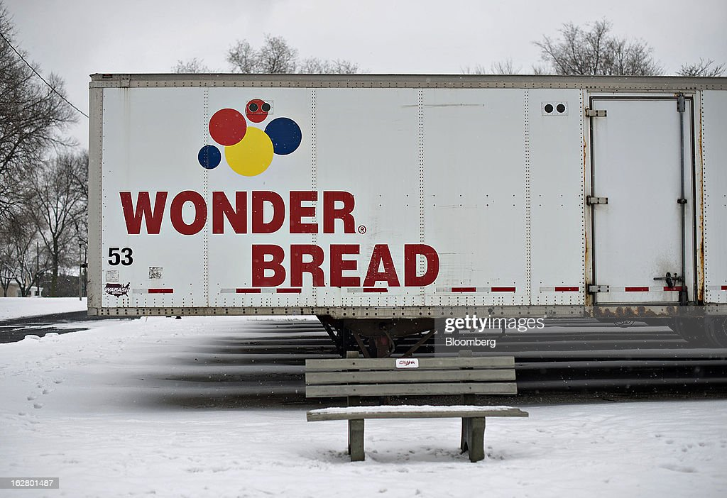 A semi-trailer sits outside an idled Hostess Brands Inc. bakery in Peoria, Illinois, U.S., on Wednesday, Feb. 27, 2013. Flowers Foods Inc., maker of packaged bakery foods, won the bidding for the majority of the bread-making business of Hostess Brands Inc., including the Wonder, Butternut, Home Pride, Merita and Nature's Pride brands, 20 bread plants, 38 depots and other assets, after no other competing offers were submitted. Photographer: Daniel Acker/Bloomberg via Getty Images