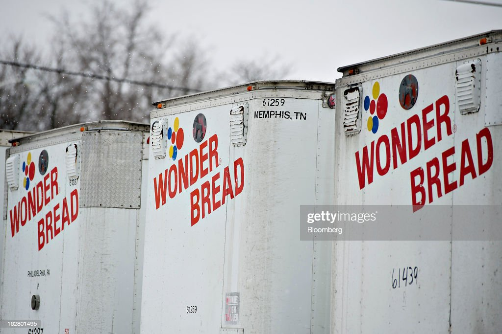 Semi-trailers sit outside an idled Hostess Brands Inc. bakery in Peoria, Illinois, U.S., on Wednesday, Feb. 27, 2013. Flowers Foods Inc., maker of packaged bakery foods, won the bidding for the majority of the bread-making business of Hostess Brands Inc., including the Wonder, Butternut, Home Pride, Merita and Nature's Pride brands, 20 bread plants, 38 depots and other assets, after no other competing offers were submitted. Photographer: Daniel Acker/Bloomberg via Getty Images