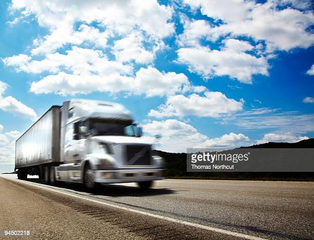 Semi-truck on freeway, low angle