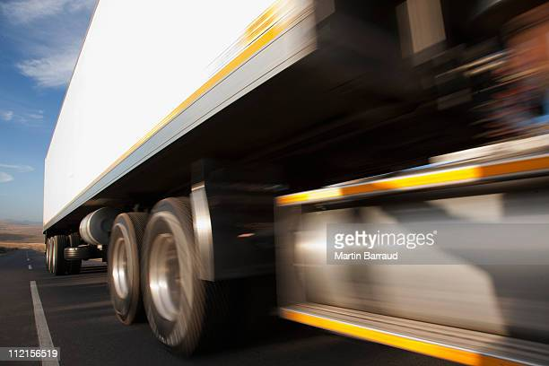 Semi-truck speeding on remote road