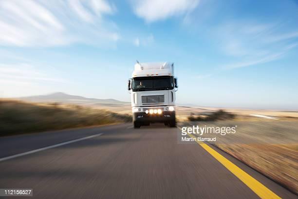 Semi-truck speeding on remote road