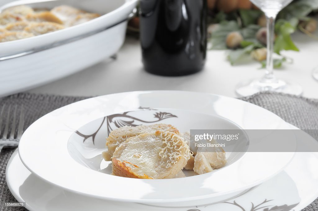 Semolina gnocchi with chestnut puree and taleggio : Stock Photo