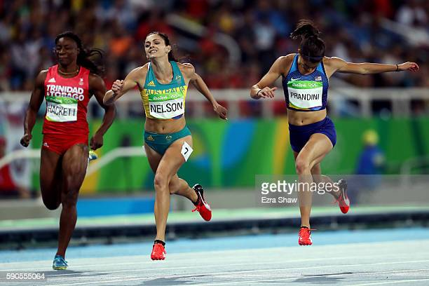 Semoy Hackett of Trinidad and Tobago Ella Nelson of Australia and Jenna Prandini of the United States compete during the Women's 200m Semifinals on...
