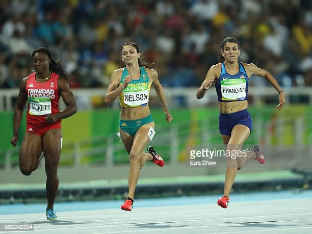 Semoy Hackett of Trinidad and Tobago Ella Nelson of Australia and Jenna Prandini of the United States compete during the Women's 200m semifinal on...