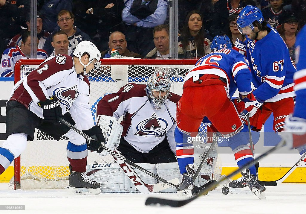 <a gi-track='captionPersonalityLinkClicked' href=/galleries/search?phrase=Semyon+Varlamov&family=editorial&specificpeople=6264893 ng-click='$event.stopPropagation()'>Semyon Varlamov</a> #1 and <a gi-track='captionPersonalityLinkClicked' href=/galleries/search?phrase=Nick+Holden&family=editorial&specificpeople=5635993 ng-click='$event.stopPropagation()'>Nick Holden</a> #2 of the Colorado Avalanche defend the net in the first period against <a gi-track='captionPersonalityLinkClicked' href=/galleries/search?phrase=Derick+Brassard&family=editorial&specificpeople=540468 ng-click='$event.stopPropagation()'>Derick Brassard</a> #16 and <a gi-track='captionPersonalityLinkClicked' href=/galleries/search?phrase=Benoit+Pouliot&family=editorial&specificpeople=879830 ng-click='$event.stopPropagation()'>Benoit Pouliot</a> #67 of the New York Rangers at Madison Square Garden on February 4, 2014 in New York City.