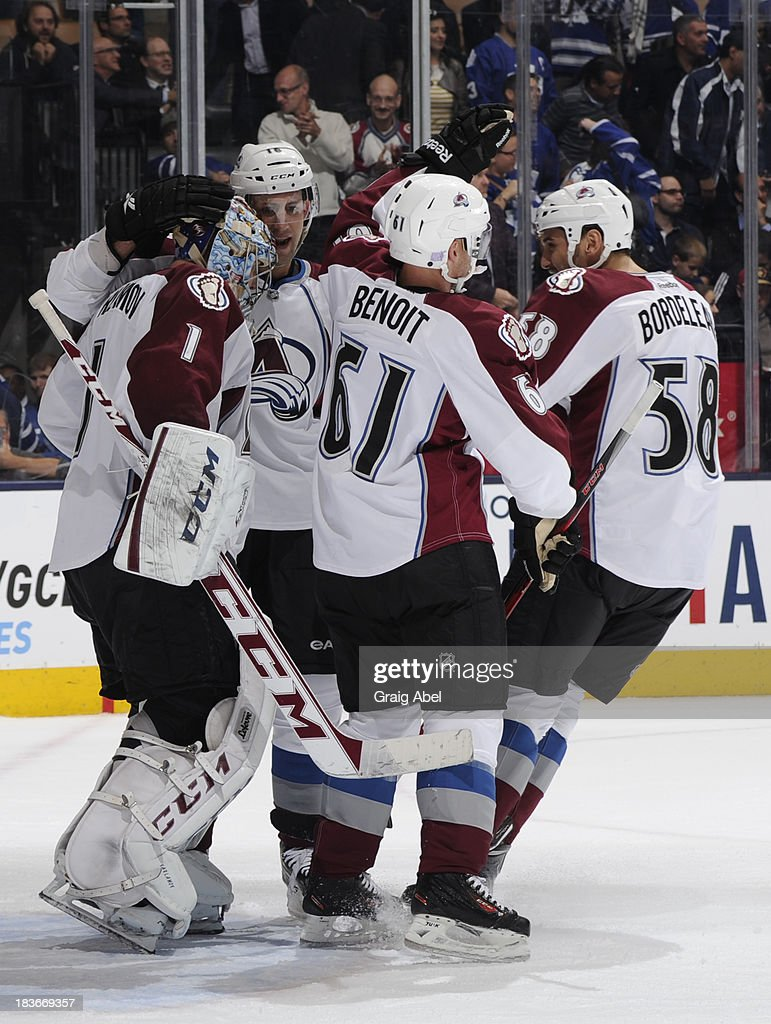 <a gi-track='captionPersonalityLinkClicked' href=/galleries/search?phrase=Semyon+Varlamov&family=editorial&specificpeople=6264893 ng-click='$event.stopPropagation()'>Semyon Varlamov</a> #1, <a gi-track='captionPersonalityLinkClicked' href=/galleries/search?phrase=Cory+Sarich&family=editorial&specificpeople=204153 ng-click='$event.stopPropagation()'>Cory Sarich</a> #16, Andre Benoit #61 and <a gi-track='captionPersonalityLinkClicked' href=/galleries/search?phrase=Patrick+Bordeleau&family=editorial&specificpeople=2282247 ng-click='$event.stopPropagation()'>Patrick Bordeleau</a> #58 of the Colorado Avalanche celebrate the teams win over the Toronto Maple Leafs during NHL game action October 8, 2013 at Air Canada Centre in Toronto, Ontario, Canada.