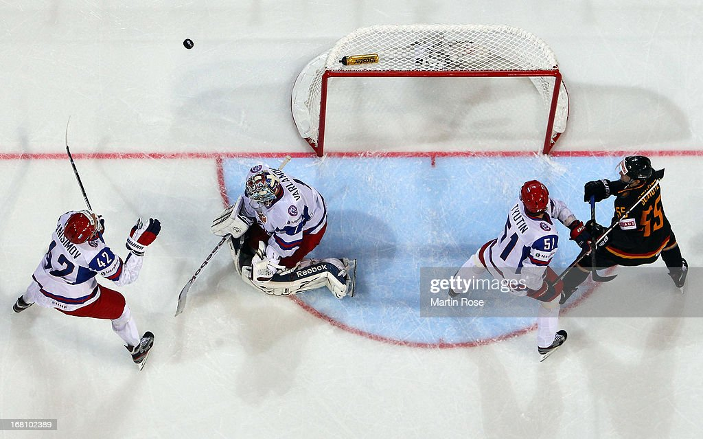 Semyon Varlamov (C), goaltender of Russia saves the shot of Felix Schuetz (#55) of Germany during the IIHF World Championship group H match between Germany and Russia at Hartwall Areena on May 5, 2013 in Helsinki, Finland.