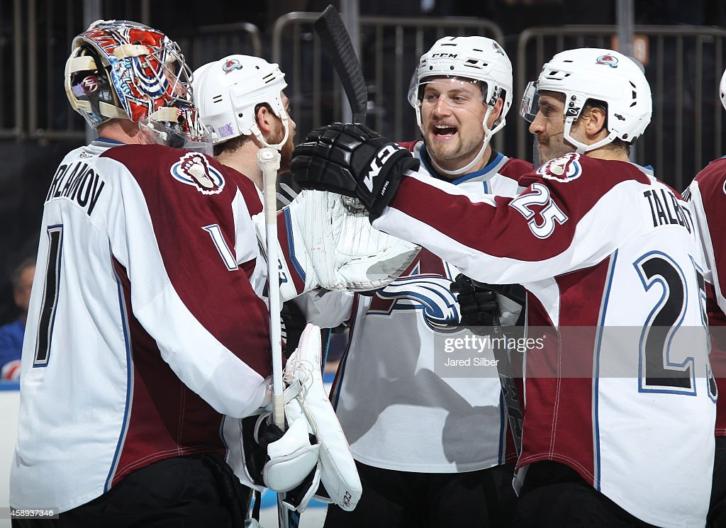 <a gi-track='captionPersonalityLinkClicked' href=/galleries/search?phrase=Semyon+Varlamov&family=editorial&specificpeople=6264893 ng-click='$event.stopPropagation()'>Semyon Varlamov</a> #1, John Mitchell #7 and <a gi-track='captionPersonalityLinkClicked' href=/galleries/search?phrase=Maxime+Talbot&family=editorial&specificpeople=2078922 ng-click='$event.stopPropagation()'>Maxime Talbot</a> #25 of the Colorado Avalanche celebrate after a 4-3 win over the New York Rangers in a shootout at Madison Square Garden on November 13, 2014 in New York City.