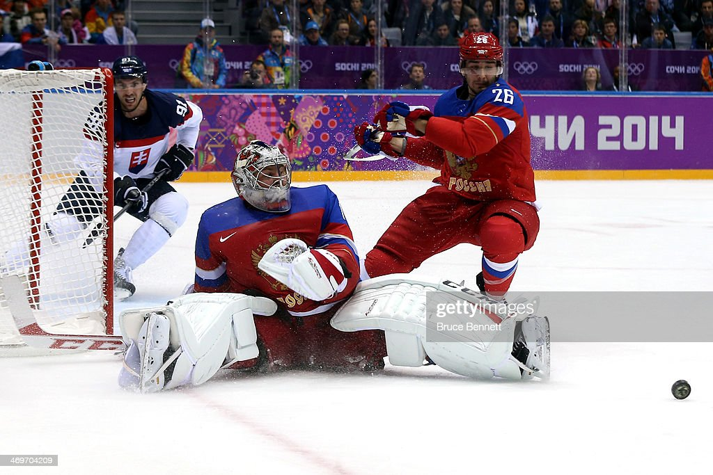 <a gi-track='captionPersonalityLinkClicked' href=/galleries/search?phrase=Semyon+Varlamov&family=editorial&specificpeople=6264893 ng-click='$event.stopPropagation()'>Semyon Varlamov</a> #1 of Russia makes a save against Slovakia during the Men's Ice Hockey Preliminary Round Group A game on day nine of the Sochi 2014 Winter Olympics at Bolshoy Ice Dome on February 16, 2014 in Sochi, Russia.