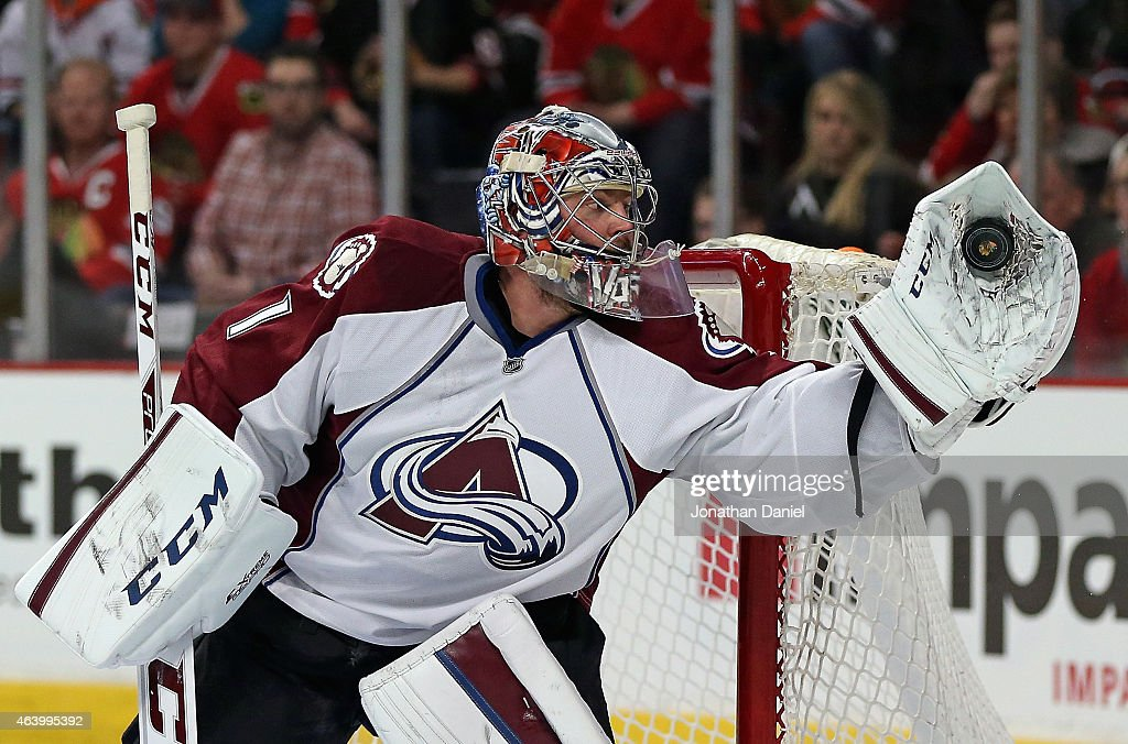 <a gi-track='captionPersonalityLinkClicked' href=/galleries/search?phrase=Semyon+Varlamov&family=editorial&specificpeople=6264893 ng-click='$event.stopPropagation()'>Semyon Varlamov</a> #1 of the Colorado Avalanche makes a glove save in the second period against the Chicago Blackhawks at the United Center on February 20, 2015 in Chicago, Illinois.