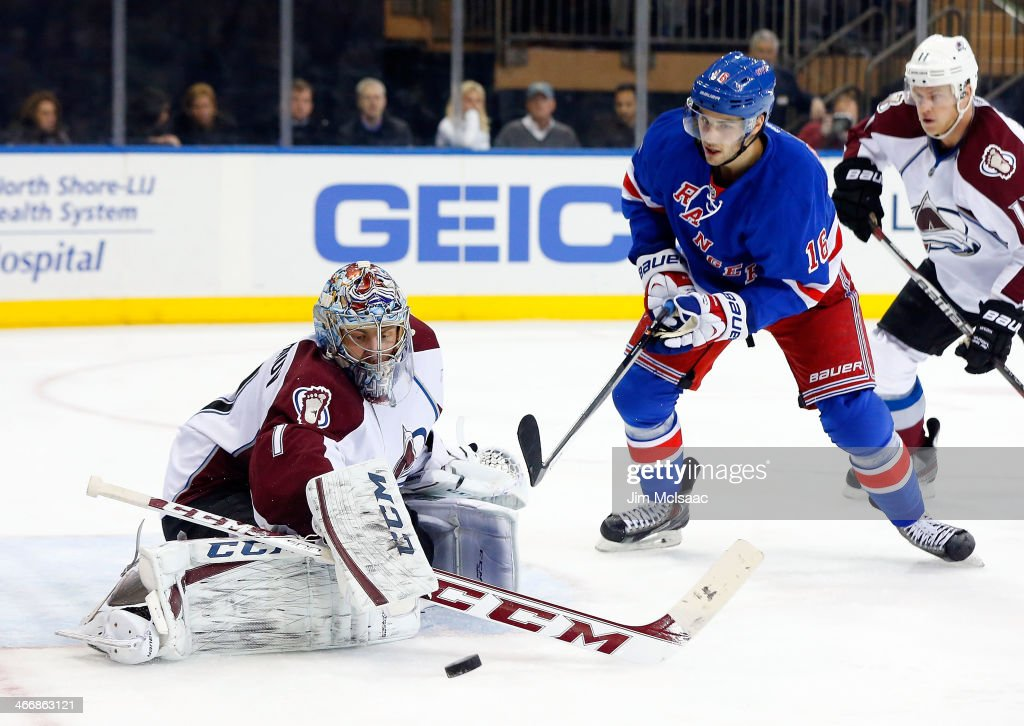 <a gi-track='captionPersonalityLinkClicked' href=/galleries/search?phrase=Semyon+Varlamov&family=editorial&specificpeople=6264893 ng-click='$event.stopPropagation()'>Semyon Varlamov</a> #1 of the Colorado Avalanche makes a save in the second period under pressure from <a gi-track='captionPersonalityLinkClicked' href=/galleries/search?phrase=Derick+Brassard&family=editorial&specificpeople=540468 ng-click='$event.stopPropagation()'>Derick Brassard</a> #16 of the New York Rangers at Madison Square Garden on February 4, 2014 in New York City.
