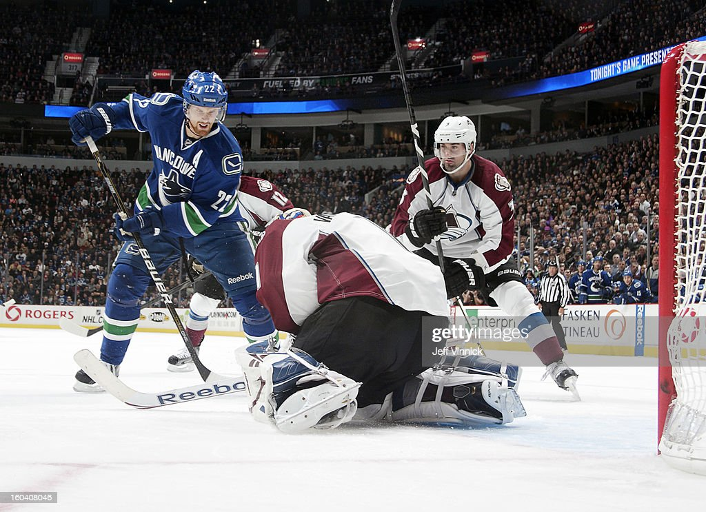 Semyon Varlamov #1 of the Colorado Avalanche makes a save on <a gi-track='captionPersonalityLinkClicked' href=/galleries/search?phrase=Daniel+Sedin&family=editorial&specificpeople=202492 ng-click='$event.stopPropagation()'>Daniel Sedin</a> #22 of the Vancouver Canucks as <a gi-track='captionPersonalityLinkClicked' href=/galleries/search?phrase=Ryan+O%27Byrne&family=editorial&specificpeople=3126048 ng-click='$event.stopPropagation()'>Ryan O'Byrne</a> #3 of the Colorado Avalanche looks for the puck during their NHL game at Rogers Arena January 30, 2013 in Vancouver, British Columbia, Canada.