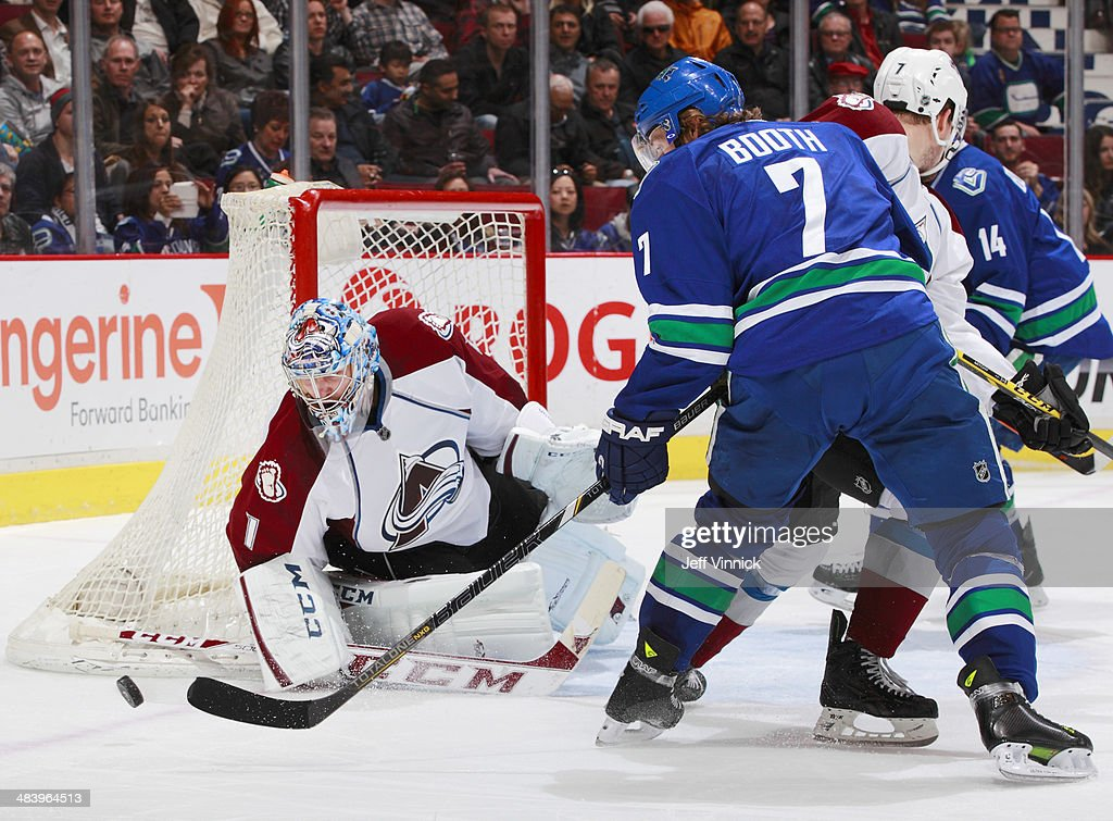 <a gi-track='captionPersonalityLinkClicked' href=/galleries/search?phrase=Semyon+Varlamov&family=editorial&specificpeople=6264893 ng-click='$event.stopPropagation()'>Semyon Varlamov</a> #1 of the Colorado Avalanche makes a save on <a gi-track='captionPersonalityLinkClicked' href=/galleries/search?phrase=David+Booth+-+Ice+Hockey+Player&family=editorial&specificpeople=1109572 ng-click='$event.stopPropagation()'>David Booth</a> #7 of the Vancouver Canucks during their NHL game at Rogers Arena April 10, 2014 in Vancouver, British Columbia, Canada. Colorado won 4-2.