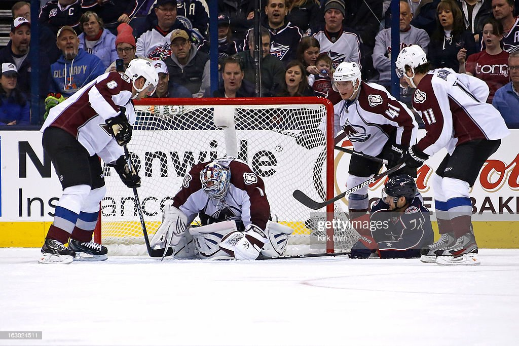 <a gi-track='captionPersonalityLinkClicked' href=/galleries/search?phrase=Semyon+Varlamov&family=editorial&specificpeople=6264893 ng-click='$event.stopPropagation()'>Semyon Varlamov</a> #1 of the Colorado Avalanche makes a save on <a gi-track='captionPersonalityLinkClicked' href=/galleries/search?phrase=Nick+Foligno&family=editorial&specificpeople=537821 ng-click='$event.stopPropagation()'>Nick Foligno</a> #71 of the Columbus Blue Jackets as <a gi-track='captionPersonalityLinkClicked' href=/galleries/search?phrase=Jan+Hejda&family=editorial&specificpeople=624333 ng-click='$event.stopPropagation()'>Jan Hejda</a> #8, Tyson Barrie #41, and <a gi-track='captionPersonalityLinkClicked' href=/galleries/search?phrase=Jamie+McGinn&family=editorial&specificpeople=537964 ng-click='$event.stopPropagation()'>Jamie McGinn</a> #11, all of the Colorado Avalanche, collapse on defense during the third period on March 3, 2013 at Nationwide Arena in Columbus, Ohio. Columbus defeated Colorado 2-1 in overtime.