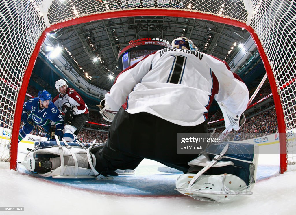 <a gi-track='captionPersonalityLinkClicked' href=/galleries/search?phrase=Semyon+Varlamov&family=editorial&specificpeople=6264893 ng-click='$event.stopPropagation()'>Semyon Varlamov</a> #1 of the Colorado Avalanche makes a save while <a gi-track='captionPersonalityLinkClicked' href=/galleries/search?phrase=Ryan+O%27Byrne&family=editorial&specificpeople=3126048 ng-click='$event.stopPropagation()'>Ryan O'Byrne</a> #3 of the Colorado Avalanche checks <a gi-track='captionPersonalityLinkClicked' href=/galleries/search?phrase=Henrik+Sedin&family=editorial&specificpeople=202574 ng-click='$event.stopPropagation()'>Henrik Sedin</a> #33 of the Vancouver Canucks during their NHL game at Rogers Arena March 28, 2013 in Vancouver, British Columbia, Canada. Vancouver won 4-1.