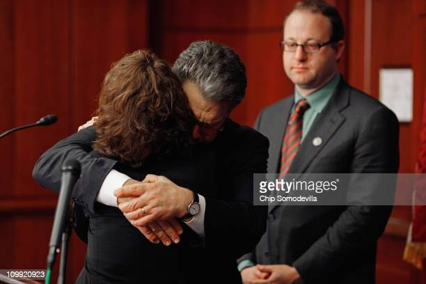 S Sen Al Franken embraces Wendy Walsh of Tehachapi California after she told the story of her son during a news conference with US Rep Jared Polis at...