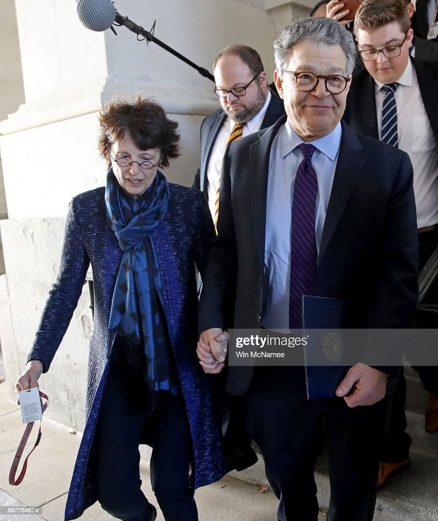 Sen. Al Franken (R) (D-MN) leaves the U.S. Capitol with his wife Franni Bryson (L) after speaking on the floor of the U.S. Senate December 7, 2017 in Washington, DC. Franken announced that he will be resigning from the U.S. Senate in the coming weeks following a barrage of allegations related to inappropriate conduct with women.