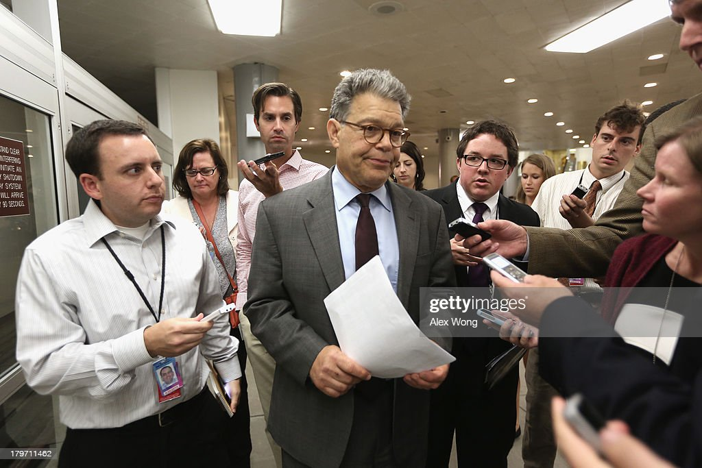 U.S. Sen. <a gi-track='captionPersonalityLinkClicked' href=/galleries/search?phrase=Al+Franken&family=editorial&specificpeople=167079 ng-click='$event.stopPropagation()'>Al Franken</a> (D-MN) (C) speaks to members of the media after a members-only closed briefing on Syria for the U.S. Senate and the House of Representatives September 6, 2013 on Capitol Hill in Washington, DC. U.S. President Barack Obama will address the American people on Syria from the White House on Tuesday.