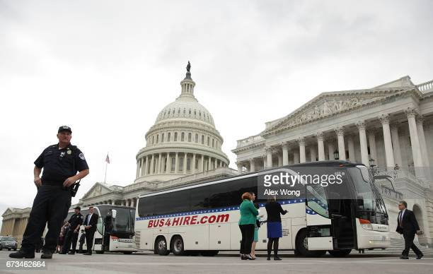 S Sen Al Franken walks towards a bus headed for the White House outside the Capitol April 26 2017 in Washington DC President Donald Trump invited all...