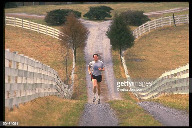 Sen Al Gore out running nr his home before voting in primary on Super Tues during his bid for Dem pres nomination