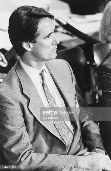 Sen Alan Cranston DCalif son Kim listening to his father's testimony sitting with his wife Colette his fatherinlaw and his Aunt Eleanor Cameron...