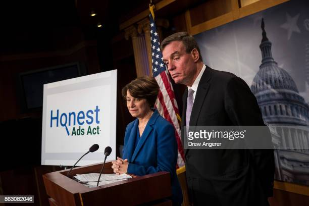 Sen Amy Klobuchar and Sen Mark Warner take questions during a press conference to introduce the 'Honest Ads Act' on Capitol Hill October 19 2017 in...