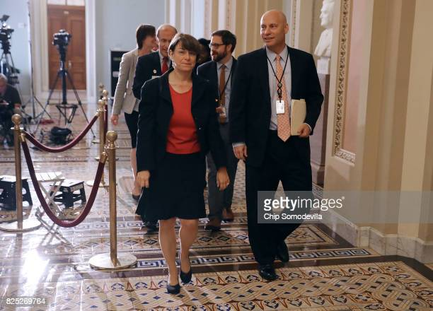 Sen Amy Klobuchar and White House Director for Legislative Affairs Marc Short leave a meeting together at the US Capitol August 1 2017 in Washington...
