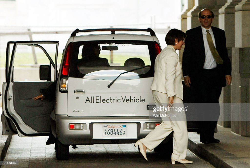 Sen. Amy Klobuchar (D-MN) exits a Miles Electric Vehicle after test driving it to the U.S Capitol June 12, 2008 in Washington, DC. Earlier, Klobuchar joined Sen. Harry Reid (D-NV) and other members of Congress in speaking out on the need to develop new technologies that can help reduce U.S. dependence on oil. The car drove is the Miles ZX40S, one of the alternative energy cars on display on Capitol Hill.