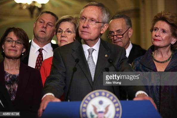 US Sen Amy Klobuchar Sen Jon Tester Sen Elizabeth Warren Senate Majority Leader Sen Harry Reid Sen Charles Schumer and Sen Debbie Stabenow listen to...