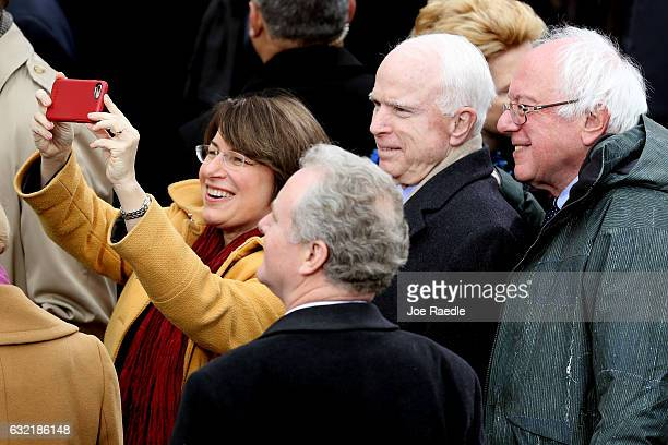 Sen Amy Klobuchar takes a selfie with Sen Chris Van Hollen Sen John McCain and Sen Bernie Sanders on the West Front of the US Capitol on January 20...