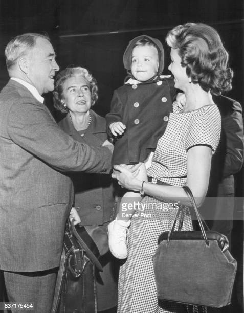 Sen and Mrs John A Carroll Return to Denver From Washington Meeting them were their daughter Mrs Diane MacDonald and grandfather Theresa Credit...