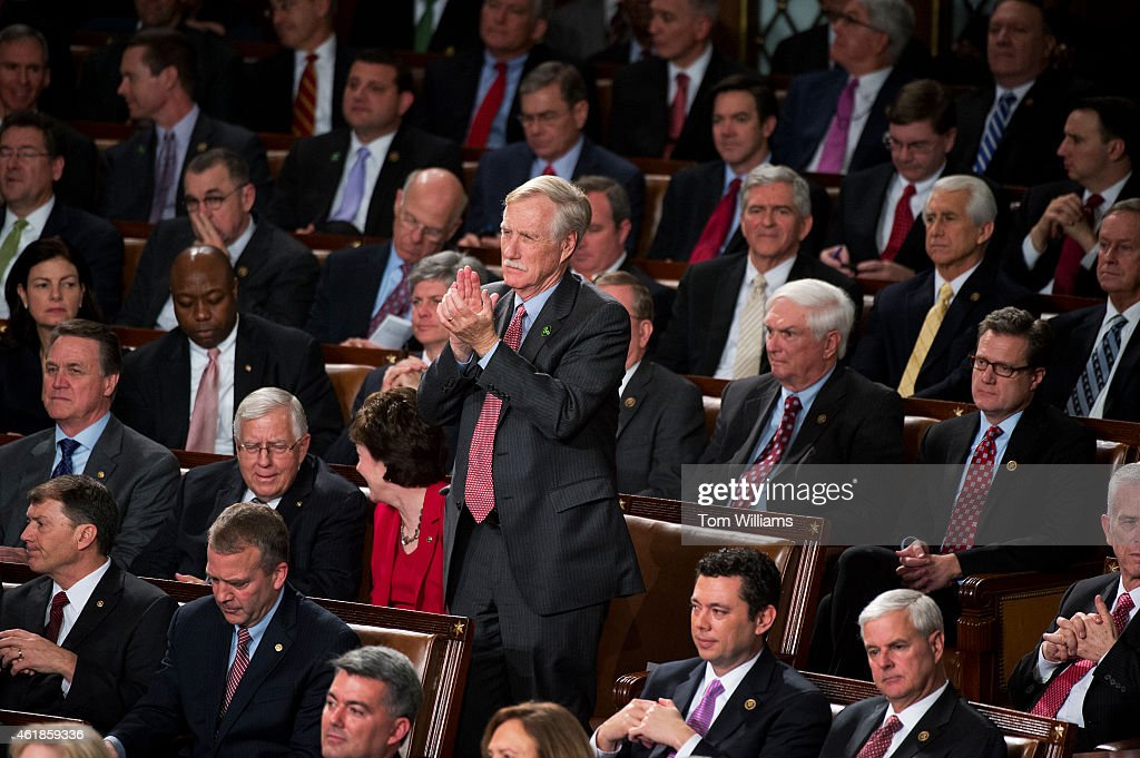 Sen. <a gi-track='captionPersonalityLinkClicked' href=/galleries/search?phrase=Angus+King&family=editorial&specificpeople=2102168 ng-click='$event.stopPropagation()'>Angus King</a>, I-Me., applauds in the Capitol's House chamber during President Barack Obama's State of the Union address, January 20, 2015.