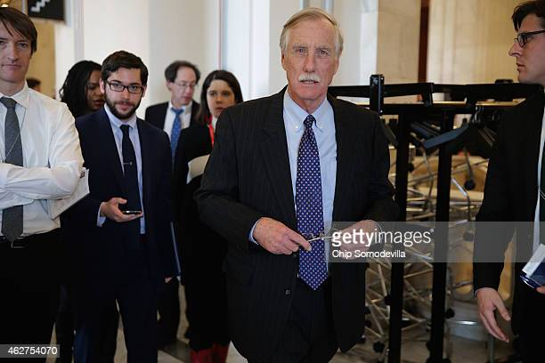 Sen Angus King leaves a Senate bipartisan lunch in the Russell Senate Office Building on Capitol Hill February 4 2015 in Washington DC Senators from...