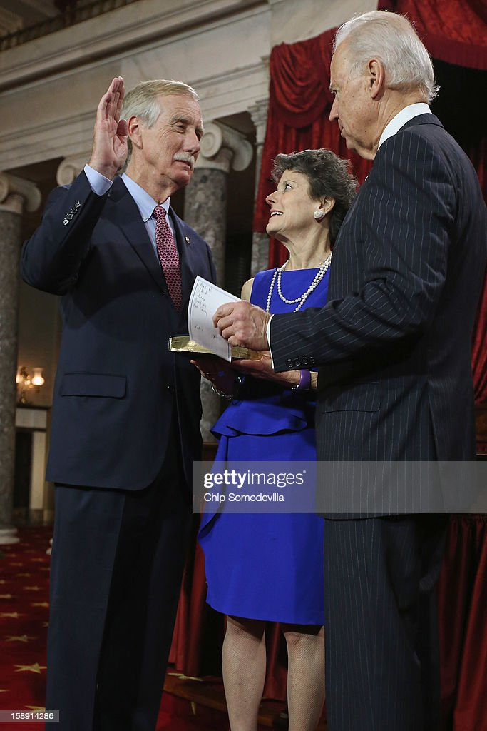 U.S. Sen. Angus King (I-ME) (L) participates in a reenacted swearing-in with his wife Mary Herman and U.S. Vice President Joe Biden in the Old Senate Chamber at the U.S. Capitol January 3, 2013 in Washington, DC. Biden swore in the newly-elected and re-elected senators earlier in the day on the floor of the current Senate chamber.
