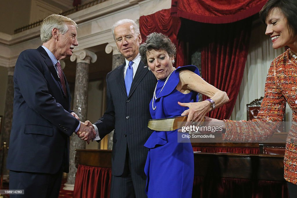 U.S. Sen. Angus King (I-ME) (L) shakes hands with U.S. Vice President Joe Biden (2nd L) as King's wife, Mary Herman 92nd R), is given a Bible before a eenacted swearing-in in the Old Senate Chamber at the U.S. Capitol January 3, 2013 in Washington, DC. Biden swore in the newly-elected and re-elected senators earlier in the day on the floor of the current Senate chamber.