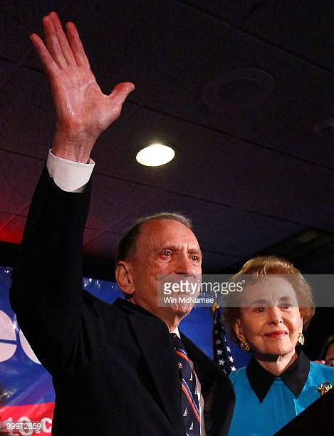 Sen Arlen Specter waves goodbye after conceding defeat at a primary night gathering of supporters and staff with his wife Joan Specter May 18 2009 in...
