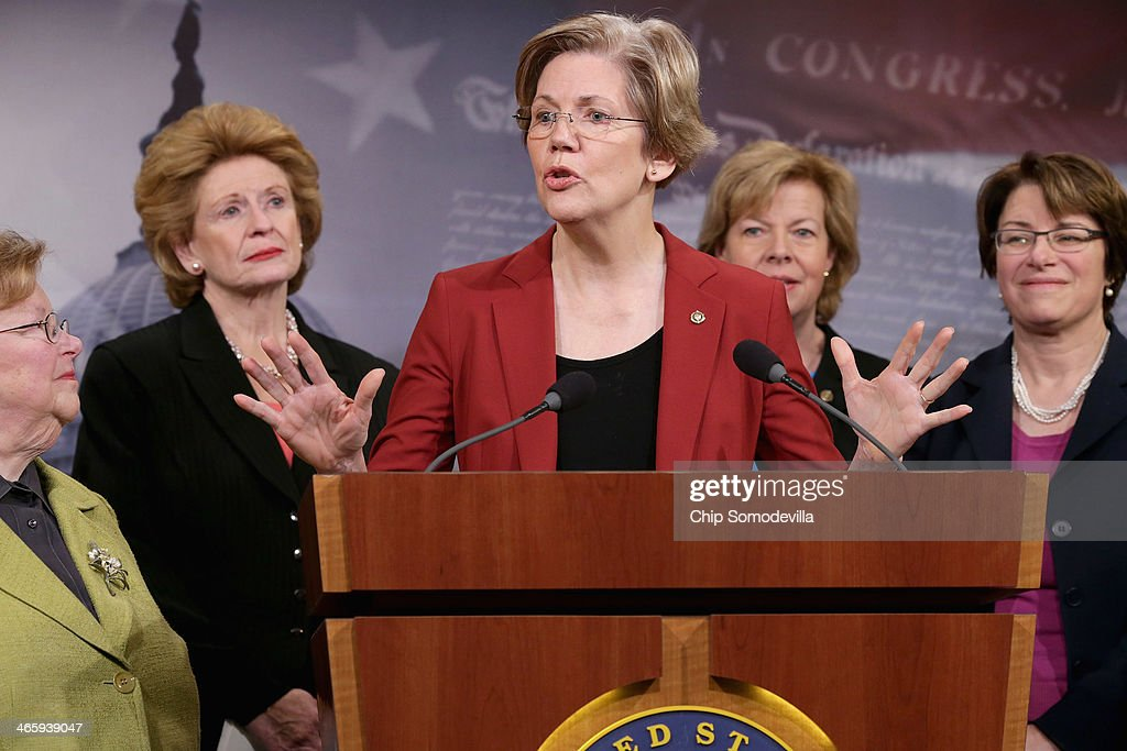 U.S. Sen. Barabara Mikulski (D-MD), U.S. Sen. Debbie Stabenow (D-MI), U.S. Sen. Elizabeth Warren (D-MA), U.S. Sen. Tammy Baldwin (D-WI) and U.S. Sen. Amy Klobuchar (D-MN) join other women Democratic senators for a news conference to announce their support for raising the minimum wage to $10.10 at the U.S. Capitol January 30, 2014 in Washington, DC. Twelve of the 16 Democratic women senators made appearances during the news conference.