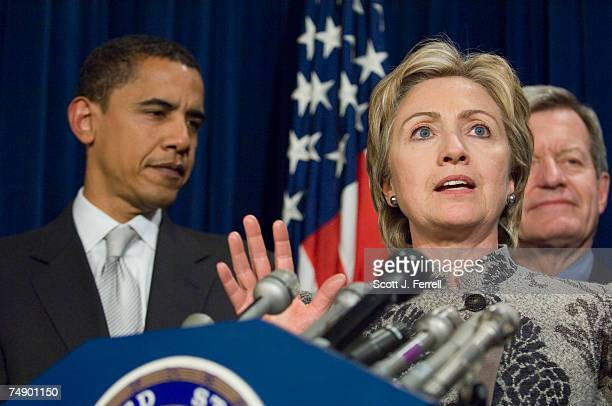 Sen Barack Obama DIll Sen Hillary Rodham Clinton DNY and Sen Max Baucus DMont during a news conference after the Senate capped a twoweek debate by...
