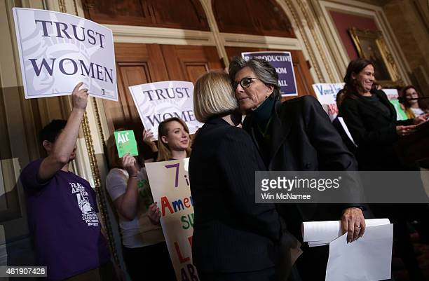S Sen Barbara Boxer embraces Sen Patty Murray after speaking at a press conference advocating women's health rights January 21 2015 at the US Capitol...