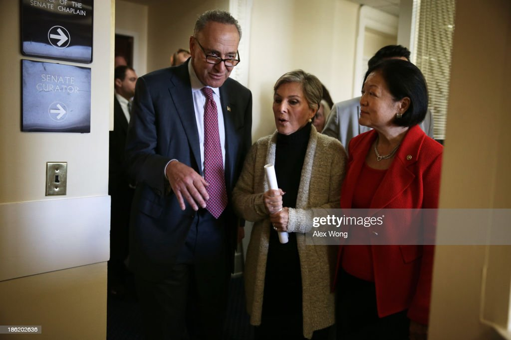 U.S. Sen. <a gi-track='captionPersonalityLinkClicked' href=/galleries/search?phrase=Barbara+Boxer&family=editorial&specificpeople=169888 ng-click='$event.stopPropagation()'>Barbara Boxer</a> (D-CA) (2nd L), Sen. <a gi-track='captionPersonalityLinkClicked' href=/galleries/search?phrase=Charles+Schumer&family=editorial&specificpeople=171249 ng-click='$event.stopPropagation()'>Charles Schumer</a> (D-NY) (L), and Sen. <a gi-track='captionPersonalityLinkClicked' href=/galleries/search?phrase=Mazie+Hirono&family=editorial&specificpeople=3461717 ng-click='$event.stopPropagation()'>Mazie Hirono</a> (D-HI) (R) leave after a news conference on debt ceiling increases October 29, 2013 on Capitol Hill in Washington, DC. The senators will introduce a new legislation, the Pay Our Bills Act, 'that would permanently allow Congress to disapprove debt ceiling increases, instead of approving them.'