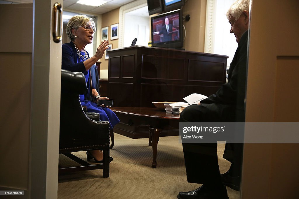 U.S. Sen. <a gi-track='captionPersonalityLinkClicked' href=/galleries/search?phrase=Barbara+Boxer&family=editorial&specificpeople=169888 ng-click='$event.stopPropagation()'>Barbara Boxer</a> (D-CA) (L) talks to Rep. Jim McDermott (D-WA) (R) prior to a news conference June 12, 2013 on Capitol Hill in Washington, DC. Boxer and McDermott held a news conference to announce that they are introducing a bill to block congressional pay if lawmakers fail to raise the debt ceiling.