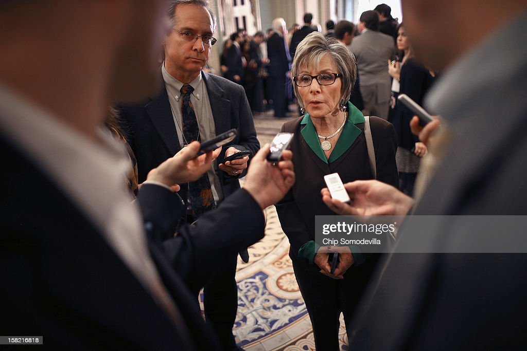 Sen. Barbara Boxer (D-CA) (C) talks to reporters after the Senate Democrats' weekly policy luncheon at the U.S. Capitol December 11, 2012 in Washington, DC. Senate Majority Leader Harry Reid (D-NV) said that a resolution to the looming 'fiscal cliff' may not appear before Christmas after Speaker of the House John Boehner (R-OH) said that President Barack Obama had yet to propose specific spending cuts.